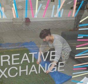 Lauren McLaughlin installing exhibition at Creative Exchange